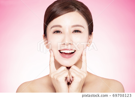closeup smiling beautiful young woman face with teeth 69708123