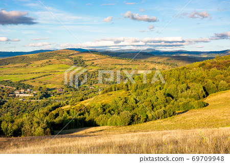 beautiful rural landscape in autumn. field on hillside in mountains in evening light 69709948