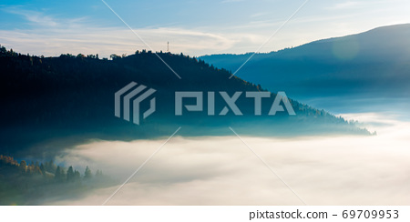 idyllic autumn landscape with cold morning fog on hillside in mountainous rural area at sunrise 69709953