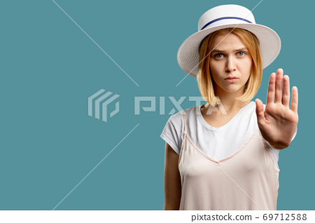 stop sign warning gesture serious woman hand 69712588