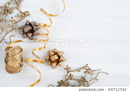 Golden Christmas toys on wooden rustic background 69712592