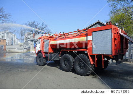 Water cannon of a firetruck shooting a high-velocity stream of water 69717893