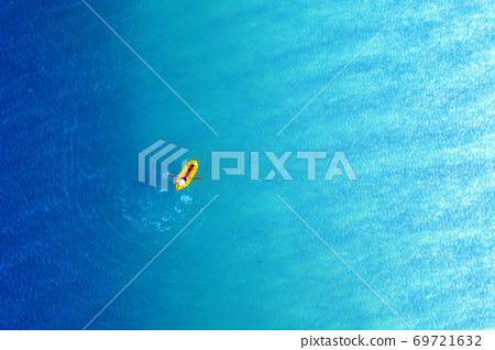 Yellow packraft rubber boat and turquoise water 69721632