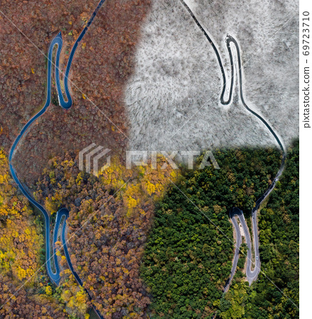 Seasons Concept summer winter fall spring Aerial view Winding road serpentine mountain pass village Brodenbach Germany 69723710