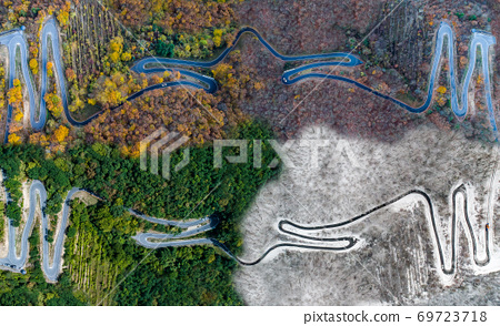 Seasons Concept summer winter fall spring Aerial view Winding road serpentine mountain pass village Brodenbach Germany 69723718