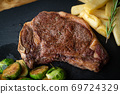 new york strip steak with french fries and brussels sprout 69724329