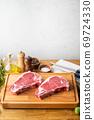 raw steak meat on cutting board in bright kitchen 69724330