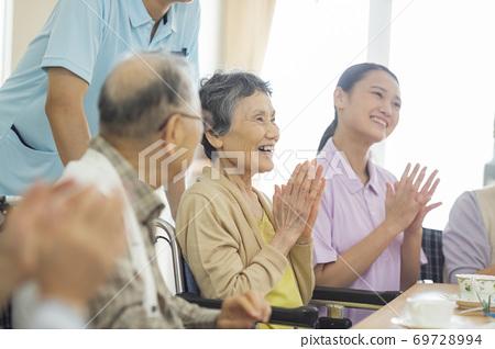 Senior women and senior men living in nursing homes 69728994