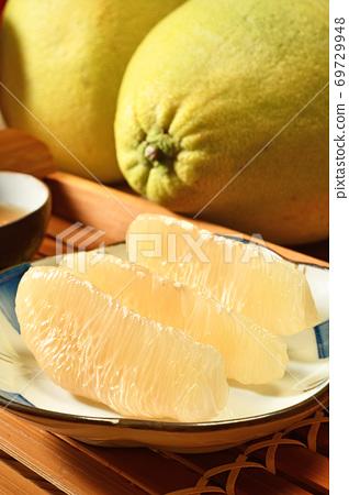 Fresh peeled pomelo on plate     69729948