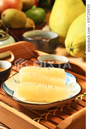Fresh peeled pomelo on plate     69729950