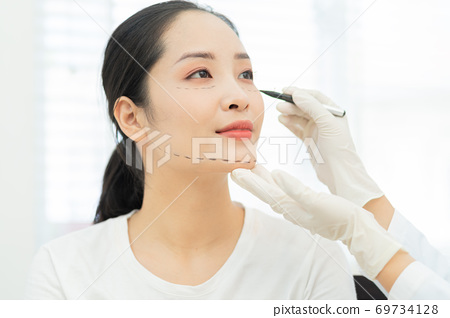Woman cosmetic surgery 69734128