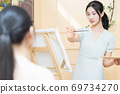 Woman painting 69734270