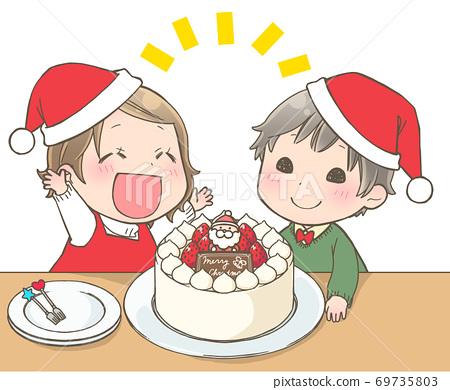 크리스마스 케이크를보고 기뻐하는 아이 69735803
