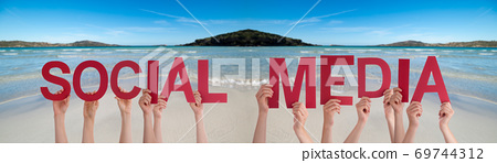 People Hands Holding Word Social Media, Ocean Background 69744312