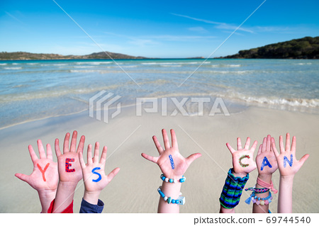 Children Hands Building Word Yes I Can, Ocean Background 69744540