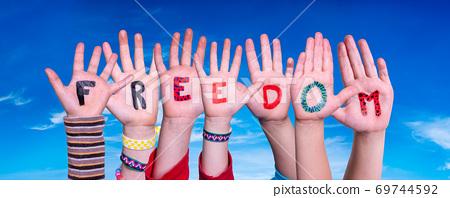 Children Hands Building Word Freedom, Blue Sky 69744592