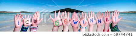 Children Hands Building Word Ich Gewinne Means I Am Winning, Ocean Background 69744741