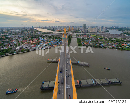 Aerial view of Bhumibol Bridge and Chao Phraya River in structure of suspension architecture concept, Urban city, Bangkok. Downtown area at sunset, Thailand. 69748121