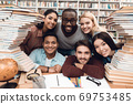 Cheerful students sitting together in the library. 69753485
