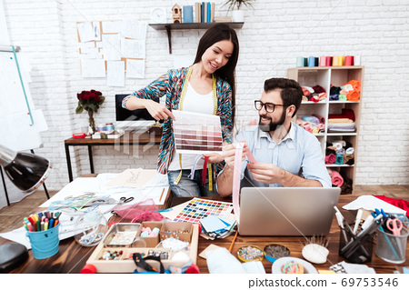 Two fashion designers looking at color palette. 69753546