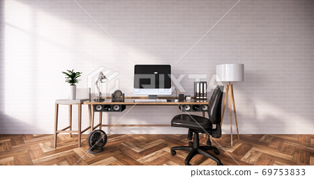Computer and office tools on desk in room interior loft style with white brick wall on wooden floor.3D rendering 69753833