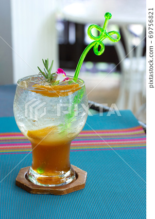 Chinese plum juice with ice soda mixed on table in restaurant 69756821