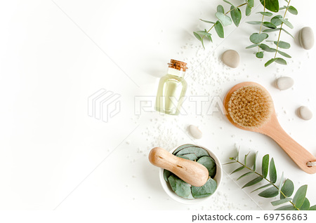 Spa Background. Natural, Organic spa cosmetics products, eco friendly bathroom accessories, eucalyptus leaves. Skincare concept on white background.  69756863
