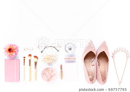 Pale pink female shoes on white background. Flat lay, top view trendy fashion feminine background. Beauty blog concept. 69757793