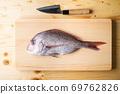 Tai, japanese seabream on wooden cutting board 69762826