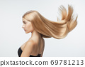 Beautiful model with long smooth, flying blonde hair 69781213