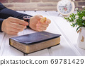 Young woman praying and Taking communion  - the wine and the bread symbols of Jesus Christ blood and body with Holy Bible 69781429