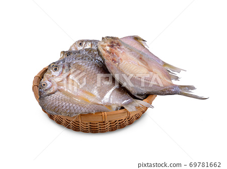 dried (one-sun) marinated butterfly silver barb in bamboo basket with white background 69781662