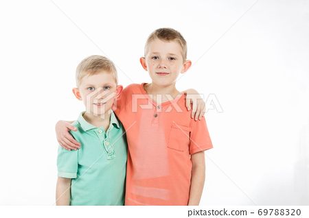brothers are standing in multi-colored t-shirts 69788320