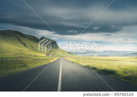 Icelandic landscape with asphalt road 69788326