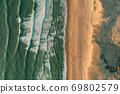 Beautiful Empty Beach textures and waves with white foam, Aerial Birds Eye Overhead Top Down View from above 69802579