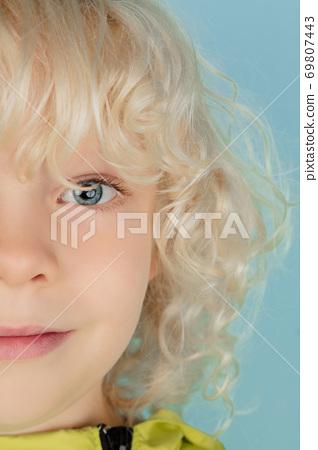 Portrait of beautiful caucasian little boy isolated on blue studio background 69807443