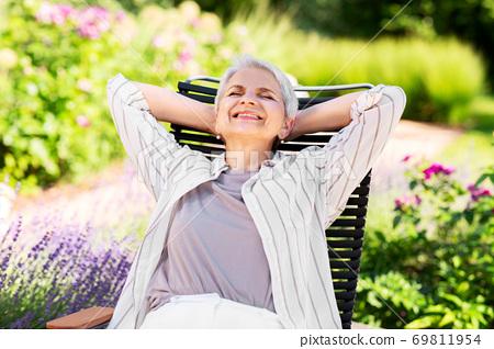 happy senior woman resting at summer garden 69811954