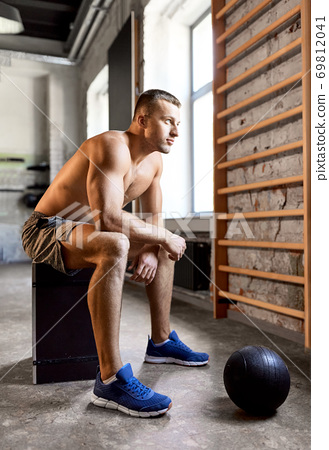 young man with medicine ball in gym 69812041