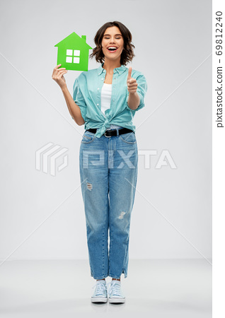 smiling young woman holding green house 69812240