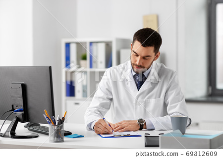 male doctor with clipboard at hospital 69812609