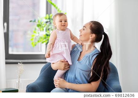 happy mother with little baby daughter at home 69812636