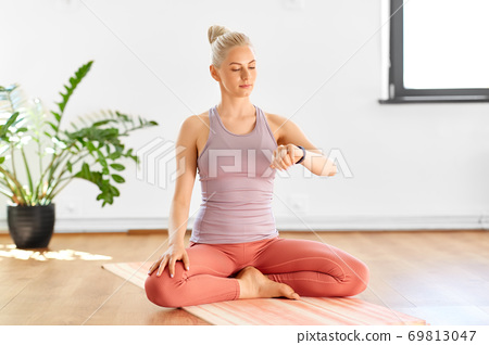 woman with fitness tracker home or yoga studio 69813047