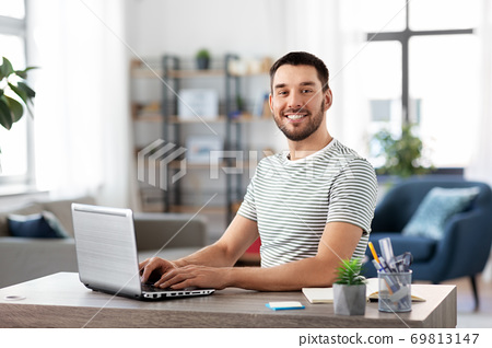 man with laptop working at home office 69813147