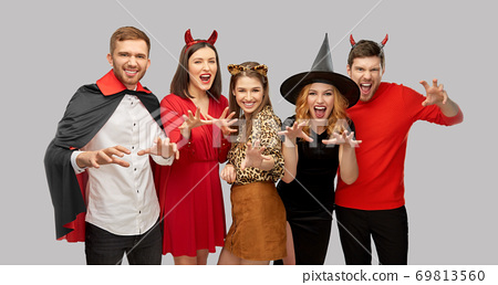 friends in halloween costumes scaring 69813560