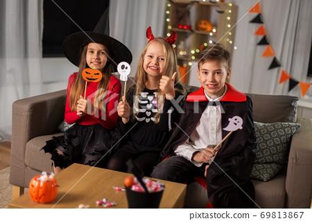 kids in halloween costumes having fun at home 69813867