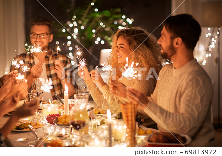 happy friends having christmas dinner at home 69813972