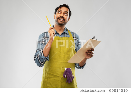 indian gardener or farmer with clipboard thinking 69814010