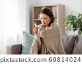 sick asian woman with nasal spray medicine at home 69814024