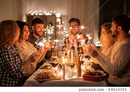 happy friends having christmas dinner at home 69814383