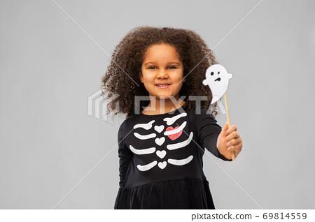 girl in black halloween dress with skeleton bones 69814559